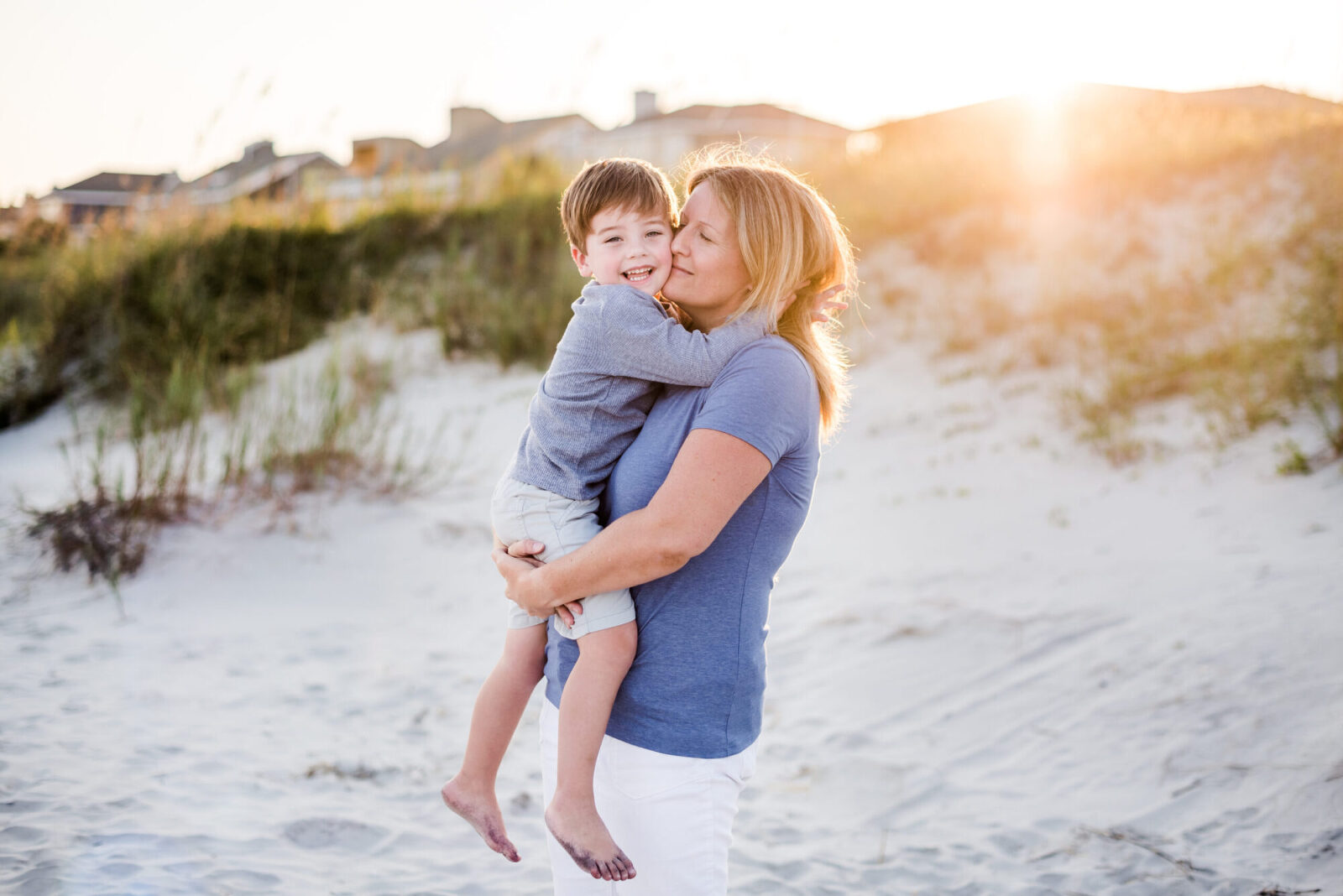 mom and son hugging at beach