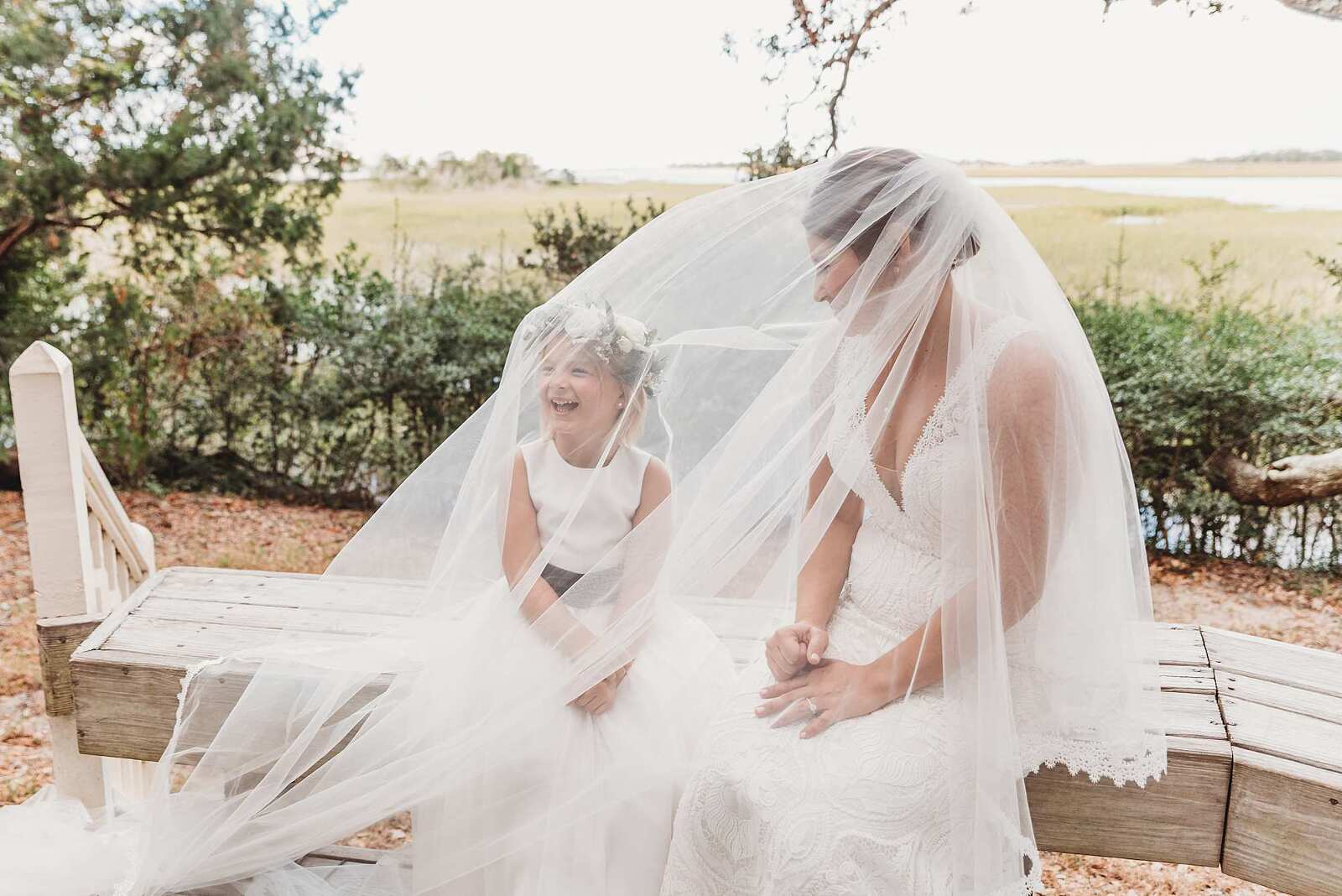 mom and daughter with veil at wedding in bald head island